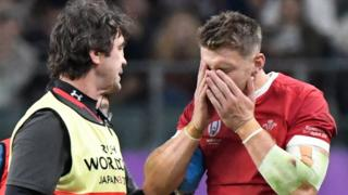 Dan Biggar looks shaken after clashing with team-mate Liam Williams