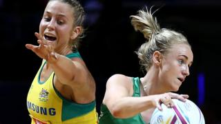 Australia's Jamie-Lee Price blocks a path for Northern Ireland opponent Neamh Woods