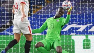 Edouard Mendy makes a save during Chelsea's Champions League game with Sevilla