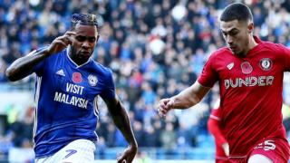 Tommy Rowe of Bristol City takes on Leandro Bacuna of Cardiff City