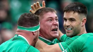 Tadhg Furlong is congratulated by team-mates Conor Murray and Rob Herring after scoring Ireland's second try