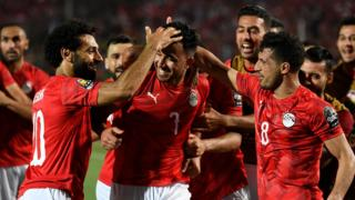 Mahmoud 'Trezeguet' Hassan (centre) celebrates with his teammates