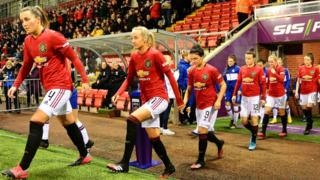 Manchester United Women walking out on to the pitch