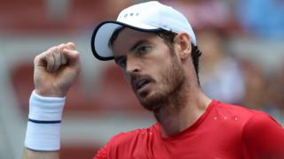 Britain's Andy Murray raises his fist in celebration after beating Cameron Norrie in round two of the China Open