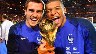 Kylian Mbappe and Antoine Griezmann celebrate winning the 2018 World Cup