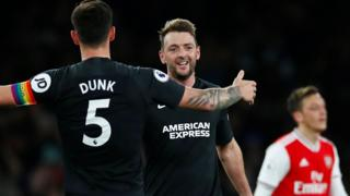 Lewis Dunk and Dale Stephens celebrate against Arsenal