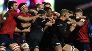 Saracens and Munster players fight