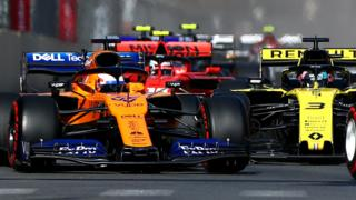 Carlos Sainz in a McLaren leads Renault's Daniel Ricciardo in the Azerbaijan Grand Prix
