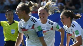 Alexandra Popp (left) celebrates scoring the first Germany goal