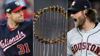 Washington Nationals' Max Scherzer, the World Series trophy and Houston Astros' Gerrit Cole
