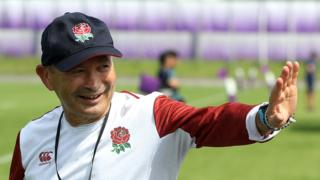 England head coach Eddie Jones waves