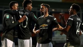 Man Utd players celebrating scoring against Luton