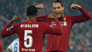 Georginio Wijnaldum and Virgil van Dijk celebrate