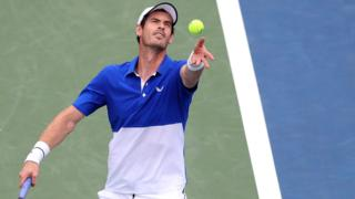 Andy Murray serves against Gasquet