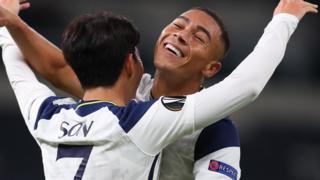 Carlos Vinicius celebrates Spurs' third with goalscorer Son Heung-min