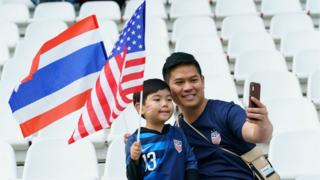 Fan's prepare for USA v Thailand in Group F
