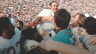 Don Shula is held aloft by his Miami Dolphins players