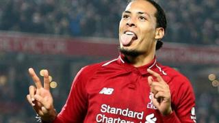 Virgil van Dijk celebrates scoring against Watford