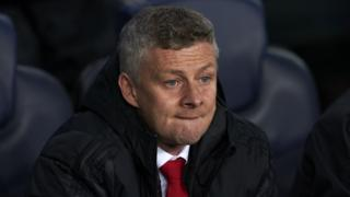 Manchester United manager Ole Gunnar Solskjaer looks glum after Champions League defeat by Barcelona