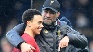 Liverpool boss Jurgen Klopp hugs a smiling Trent Alexander-Arnold after victory over Fulham