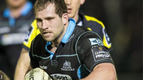 Glasgow hooker Fraser Brown takes on the Ulster defence
