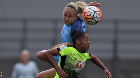 Steph Houghton of Manchester City Women leaps highest against Jade Boho Sayo of Reading FC Women