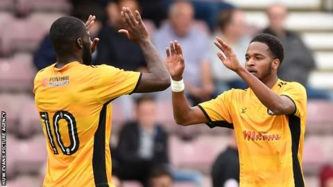 Lamar Reynolds (right) celebrates his goal against Northampton