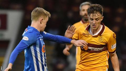 Ross MacLean (right) passed up a good chance for Motherwell in the first half