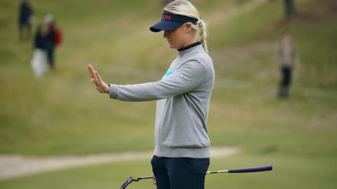 Charley Hull of England goes through her pre-putt routine on the 13th green during the final round of the TOTO Japan Classic