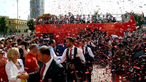 A tickertape welcome for the Albanian team