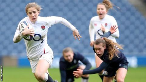 England's Abby Dow runs with the ball