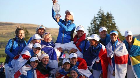 Catriona Matthew lifts the Solheim Cup