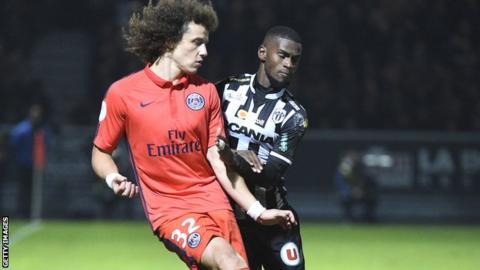 Abdoul Camara (right) in action for Angers against PSG defender David Luiz