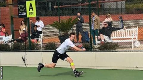 Andy Murray hits practice court with junior Aidan McHugh