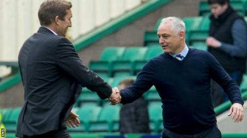 Hibs boss Alan Stubbs shakes hands with Raith manager Ray McKinnon