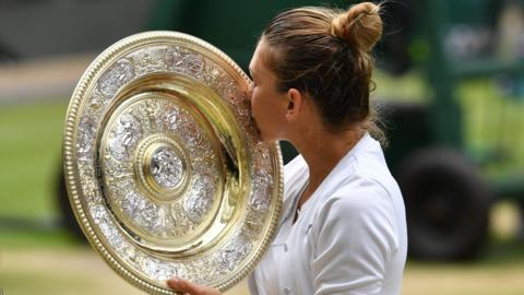 Romania's Simona Halep kisses the Venus Rosewater Dish trophy after beating US player Serena Williams during their women's singles final on day twelve of the 2019 Wimbledon Championships at The All England Lawn Tennis Club in Wimbledon, southwest London, on July 13, 2019. (Photo by GLYN KIRK / AFP) / RESTRICTED TO EDITORIAL USE (Photo credit should read GLYN KIRK/AFP/Getty Images)