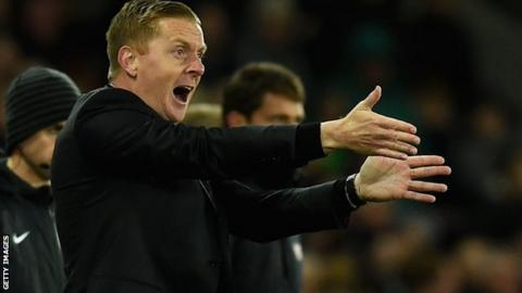 Swansea manager Garry Monk gesticulates tom his players