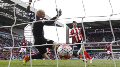 Shane Long scores past Brad Guzan