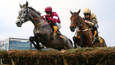 Petit Mouchoir edges ahead of Nichols Canyon before going on to win the Ryanair Hurdle