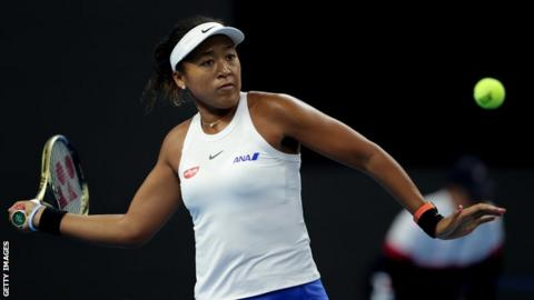 Naomi Osaka plays a forehand in semi-final victory over Caroline Wozniacki in the China Open