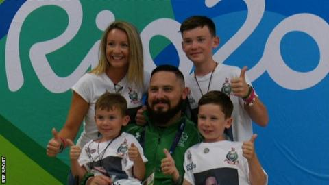 Phillip Eaglesham with his wife Julie and sons Mason, Travis and Tyler after competing in Rio on Tuesday