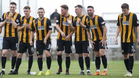 East Fife players are all smiles as they win the shoot-out against Hearts