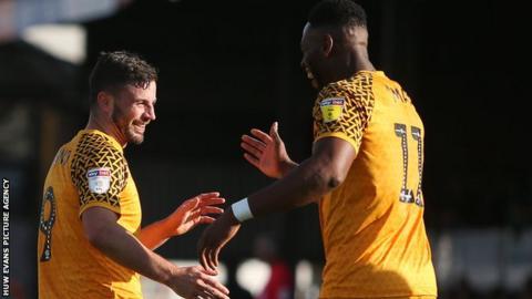Padraig Amond celebrates after scoring Newport's first goal