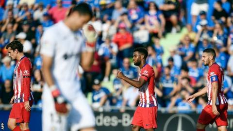 Atletico Madrid's players celebrate scoring against Getafe