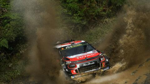 Mads Ostberg and Eriksen Torstein, of Norway, compete in the World Rally Championship in Australia