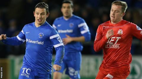 Ballinamallard's Shane McCabe is chased by Portadown's Mark McAllister at Ferney Park