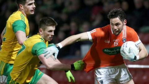 Donegal's Eoghan Ban Gallagher gives Oisin Maclomhair a tug during the semi-final