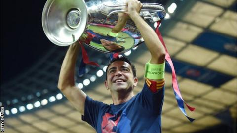 Xavi lifts the Champions League trophy