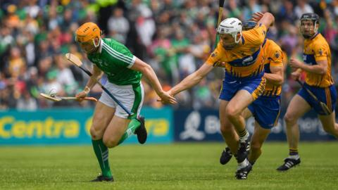 Ennis , Ireland - 17 June 2018; Seamus Flanagan of Limerick in action against Conor Cleary of Clare during the Munster GAA Hurling Senior Championship Round 5 match between Clare and Limerick at Cusack Park in Ennis, Clare. (Photo By Ray McManus/Sportsfile via Getty Images)