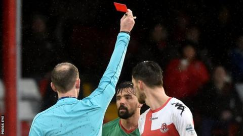 Nacho Novo is red carded in Glentoran's defeat by Crusaders on 14 January